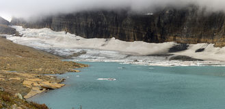 Grinnell Glacier and Mt Gould Covered with Blanket of Clouds Royalty Free Stock Photography