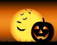 Grinning тыква с летучими мышами на backgound хеллоуине Стоковое Изображение