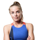 Grinning Blue eyed blond girl. With tail hair in sportswear with crossed arms and front standing on white isolated background Royalty Free Stock Image