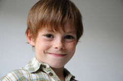 Grinning boy. With a lot of freckles Royalty Free Stock Image