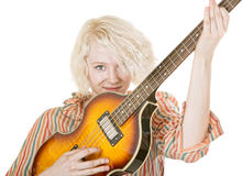 Grinning Female Guitarist Royalty Free Stock Images