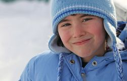 Grinning girl in winter coat Stock Photo