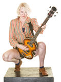 Grinning Guitar Player. Grinning female guitar player on isolated background royalty free stock photography