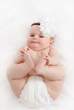 Grinning infant baby. The first year of the new life Royalty Free Stock Photo