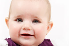Grinning infant baby. The first year of the new life Royalty Free Stock Image