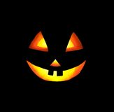 A Grinning Jack O Lantern on the Black Background Royalty Free Stock Images