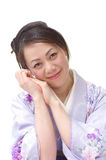 Grinning Japanese woman in Kimono Stock Photos