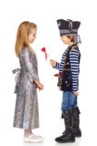 Grinning little boy pirate. Full length little boy wearing pirate costume presenting small heart shape to his lady, over white background Stock Image