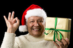 Grinning Male Senior With Gift Gesturing OK Sign Stock Images