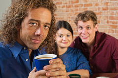 Grinning Man with Coffee Mug Stock Image