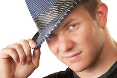 Grinning Man in Fedora Hat. Grinning young Caucasian man in fedora hat on isolated background stock photo