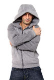 Grinning Man wearing hooded sweater. Grinning man wearing sweater with hood over his head Royalty Free Stock Photo