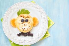 Grinning monkey funny Halloween pancake. Funny Halloween pancake with scary monkey face Royalty Free Stock Image