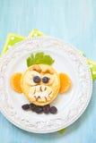 Grinning monkey funny Halloween pancake. Funny Halloween pancake with scary monkey face Stock Image