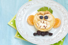 Grinning monkey funny Halloween pancake Stock Images