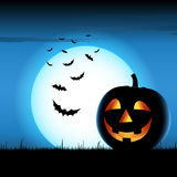 Grinning pumpkin with bats on blue  Royalty Free Stock Photo