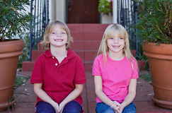 Grinning Twins Stock Images