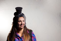 Grinning woman wearing a party top hat Royalty Free Stock Photography