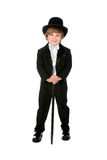 Grinning young boy in black tuxedo. Young boy grinning and wearing his black tuxedo Stock Image