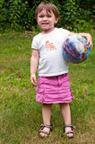 Grinning Young Girl with Her Ball Stock Image