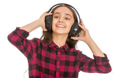 Grins teen girl holding hands big black headphones Royalty Free Stock Photography