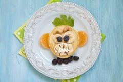 Grinsender Affe lustiger Halloween-Pfannkuchen Lizenzfreies Stockfoto