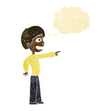 grinsender Junge der Karikatur, der mit Gedankenblase zeigt Stockfotos