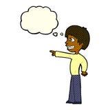 grinsender Junge der Karikatur, der mit Gedankenblase zeigt Stockfoto