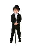 Grinsender junger Junge im schwarzen Smoking Stockbild