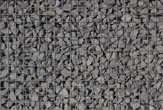 Grintachtergrond in een gabionclose-up stock fotografie