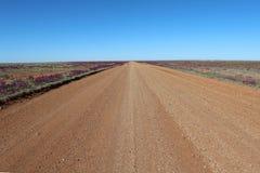 Grintweg in niets van Australië Stock Foto