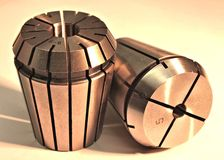 Collets - grip chucks. Grip chucks -tooling for machinery as industrial shiny still-life objects stock photo