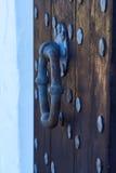 Grip on massive wooden door. Metal grip on massive wooden door Royalty Free Stock Photo