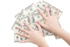 gripande pengar Arkivfoto