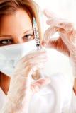 Gripe: Salir burbujas de aire de vacuna fotografía de archivo