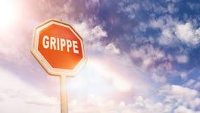 Grippe γερμανικά για τη γρίπη στο κόκκινο σημάδι οδικών στάσεων κυκλοφορίας Στοκ εικόνα με δικαίωμα ελεύθερης χρήσης