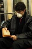 Grippe in der Untergrundbahn Stockbilder