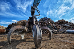 Gripper excavator on a scrap yard. Stock Image