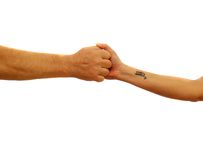 Gripping Hands Stock Images