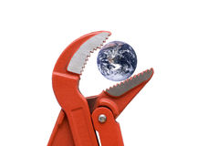Gripping planet earth. Water pump pliers with planet earth, NASA PD image used Royalty Free Stock Photography