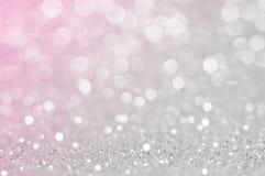 Gris-clair abstrait, la couleur De de rose de ruban a focalisé le fond circulaire Lumière de nuit ou fond de salutation de saison photo stock