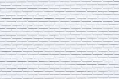 Gris y fondo blanco envejecido de la pared de ladrillo de la pintura en el sitio rural, bloques oxidados sucios de color de la te fotos de archivo libres de regalías