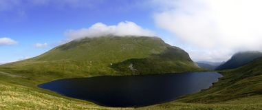 Grisedale Tarn and Helvellyn Stock Photo