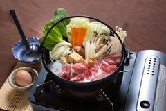 Grisköttbuk Sukiyaki royaltyfria bilder