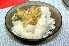 Grisköttkött med ris Arkivfoto