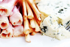 Grissini. Plate of grissini blue cheese and prosciutto - food and drink stock photos