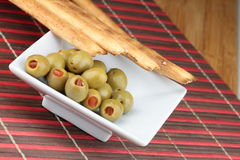 Grissini bread. Italian Grissini bread stick and olives with red pepper Stock Photo