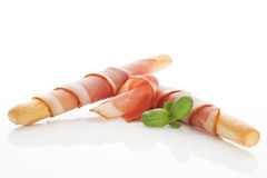 Grissini bread and prosciutto ham. Royalty Free Stock Photo