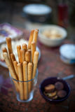 Grissini bread sticks. Closeup of Grissini bread sticks in a glass on a table Stock Photo