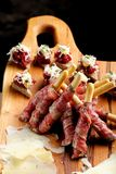 Grissini bread sticks with ham, Cheese, basil Stock Photography